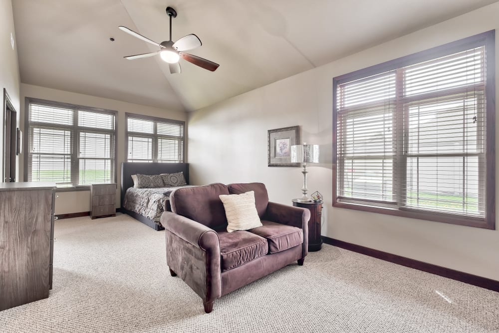 A bedroom and living room open floor plan at The Landings of Kaukauna in Kaukauna, Wisconsin