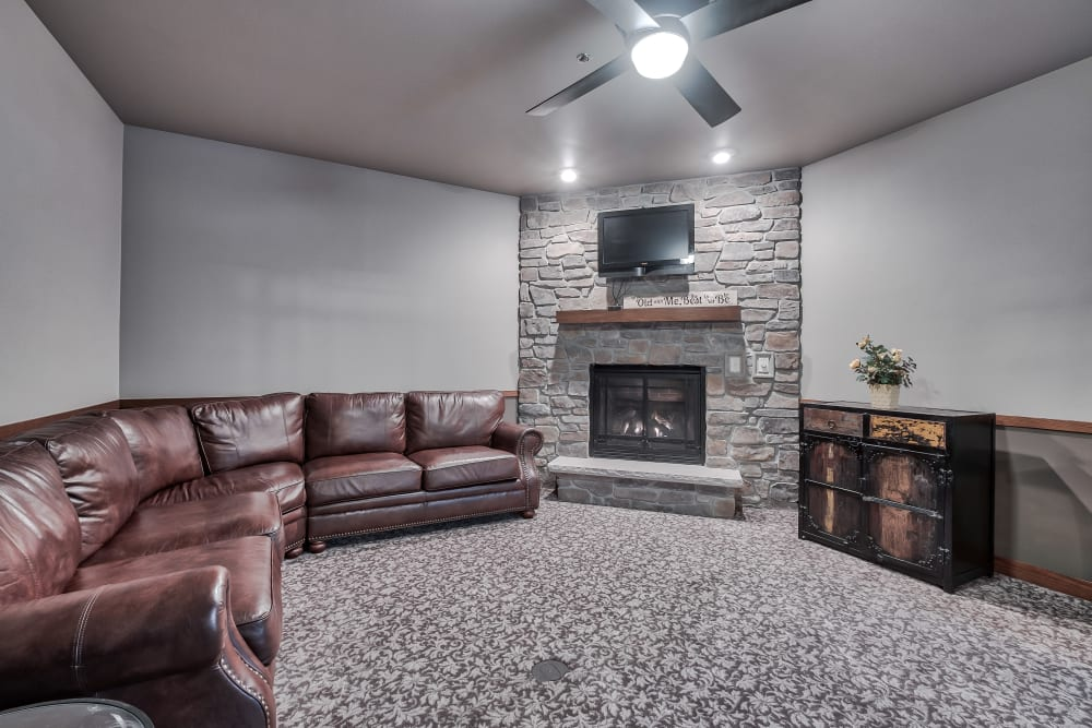 A common area with a fireplace at The Landings of Kaukauna in Kaukauna, Wisconsin