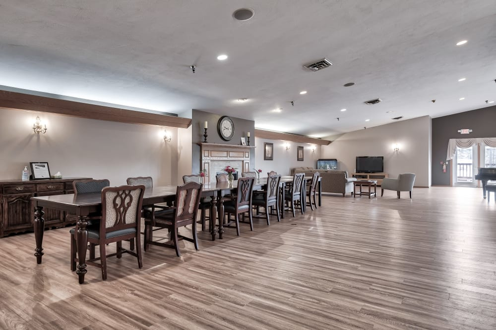 A spacious dining hall with hardwood-style floors at Bishop's Court in Allouez, Wisconsin