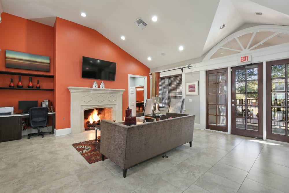 Clubhouse with a fireplace at The Lyndon in Irving, Texas