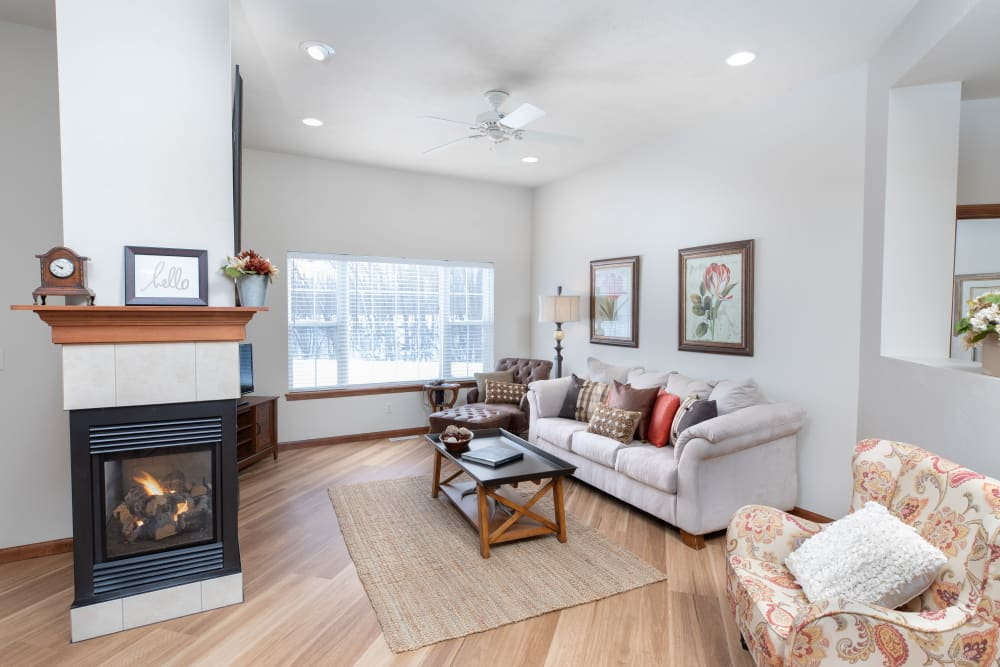 Living room with fireplace at Touchmark on West Prospect