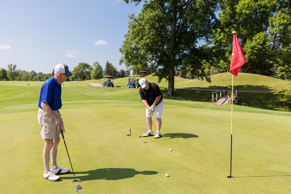 Residents golfing at Touchmark on West Prospect