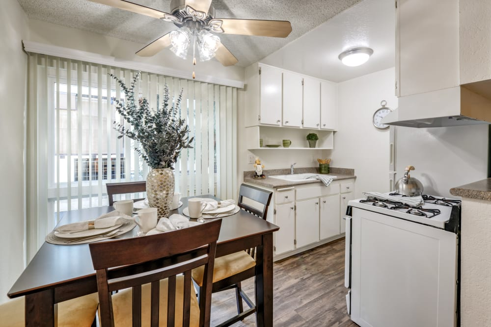 Dining room and kitchen at The Embassy Apartments in Sherman Oaks, CA