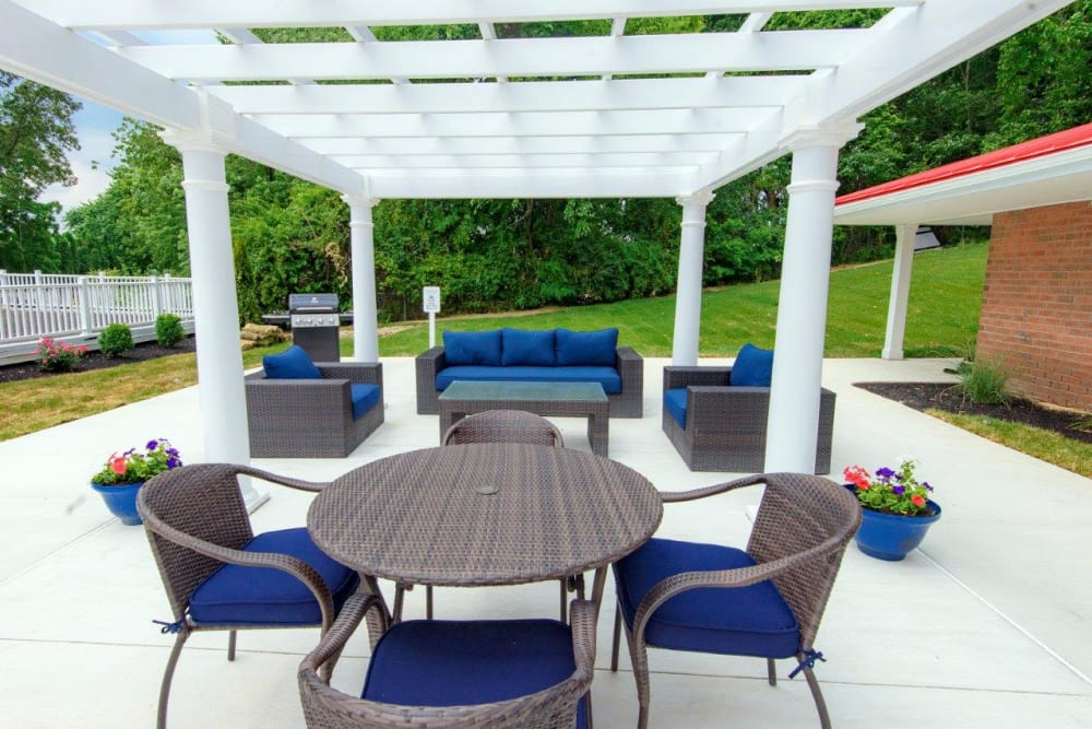 Outdoor patio lounge at Strafford Station Apartments in Wayne, Pennsylvania