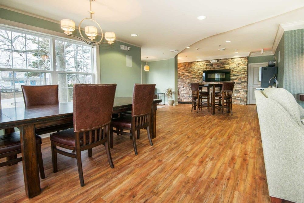Clubhouse with wood flooring at Strafford Station Apartments in Wayne, Pennsylvania