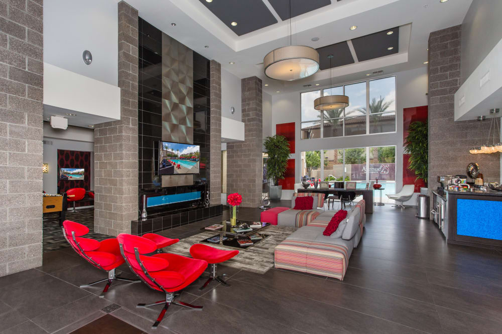 Community lounge with comfortable seating near Avenue 25 Apartments in Phoenix, Arizona