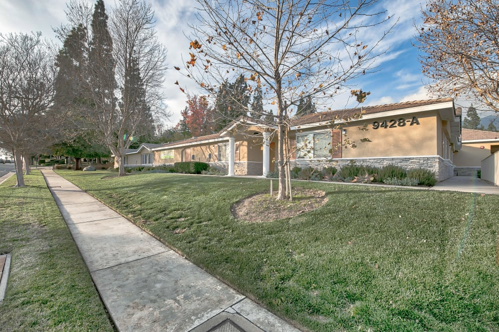Sidewalk and front lawn in front of senior apartments at Sunlit Gardens in Alta Loma, California