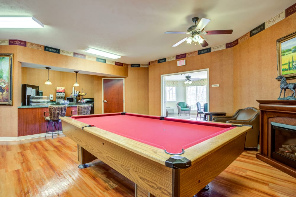 Billiards table with fireplace at Morrison Woods Health Campus in Muncie, Indiana