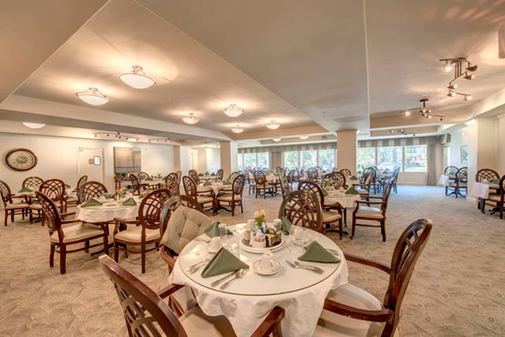 Warmly lit main dining hall at Cypress Place in Ventura, California