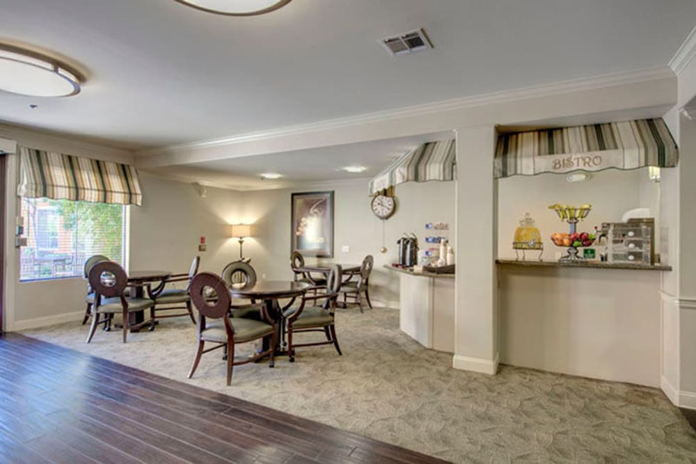 Secondary community dining room with access to a full kitchen at Cypress Place in Ventura, California