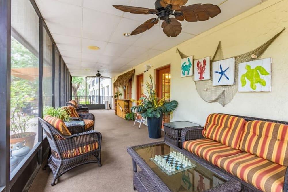 Covered patio seating at Grand Villa of Sarasota in Sarasota, Florida