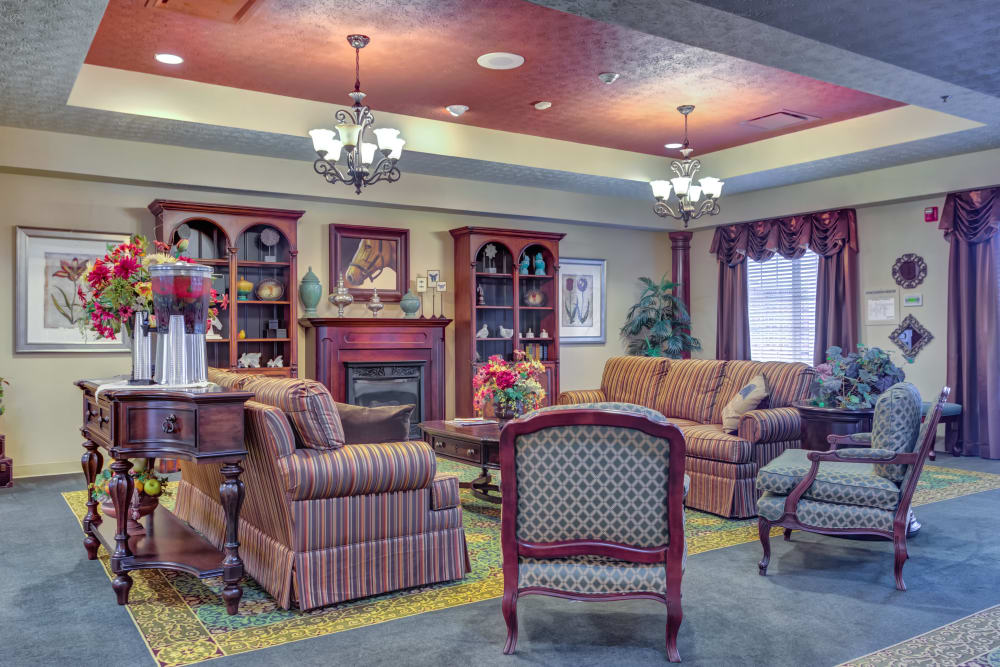 Lounge with a fireplace at The Willows at Hamburg in Lexington, Kentucky