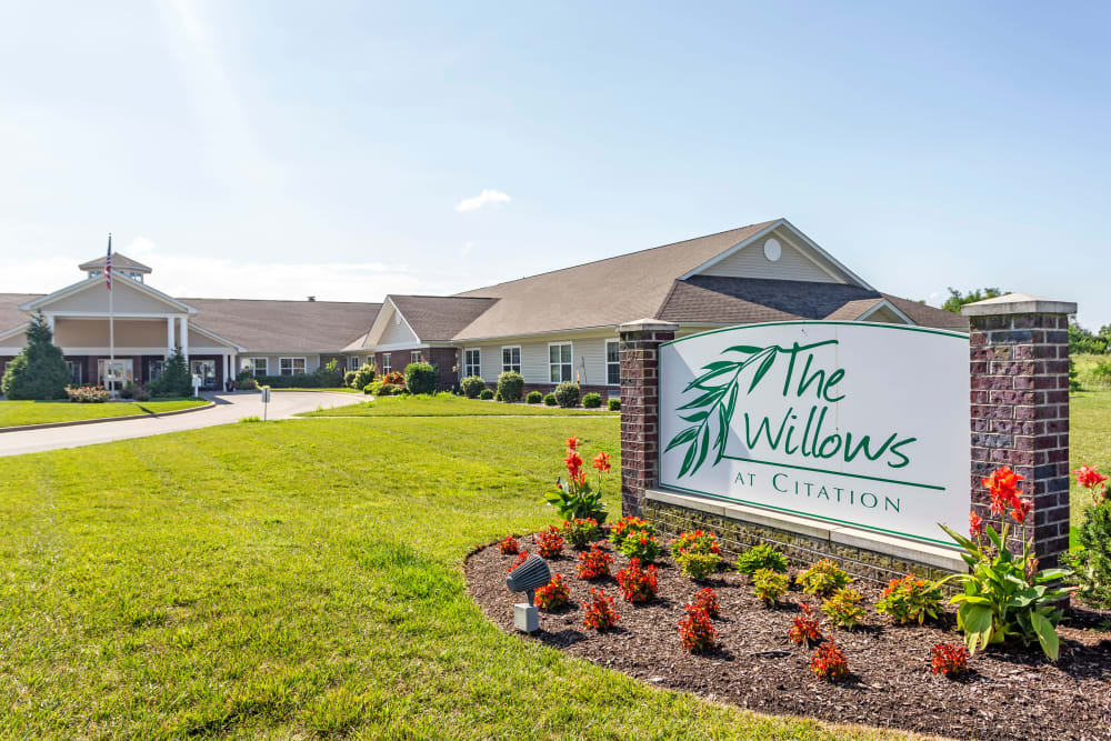 Front entrance with landscaping at The Willows at Citation in Lexington, Kentucky