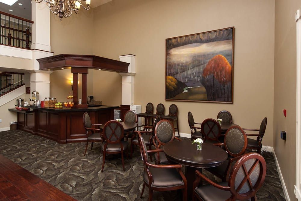 Community Café corner with a serving station and lots of seating at Claremont Place in Claremont, California