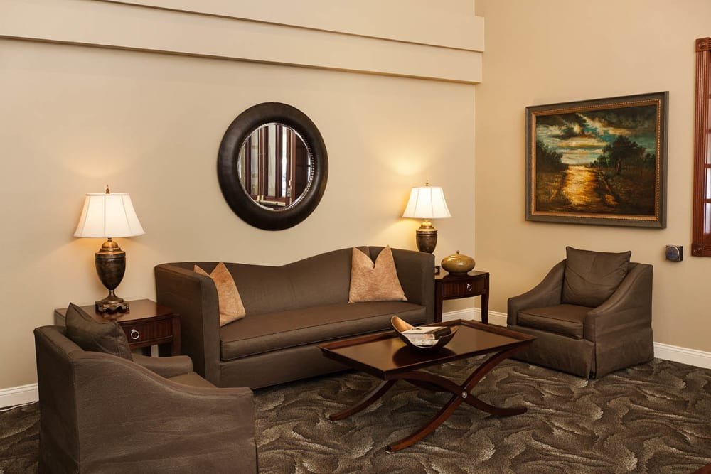 Brown couches arranged around a coffee table at Claremont Place in Claremont, California