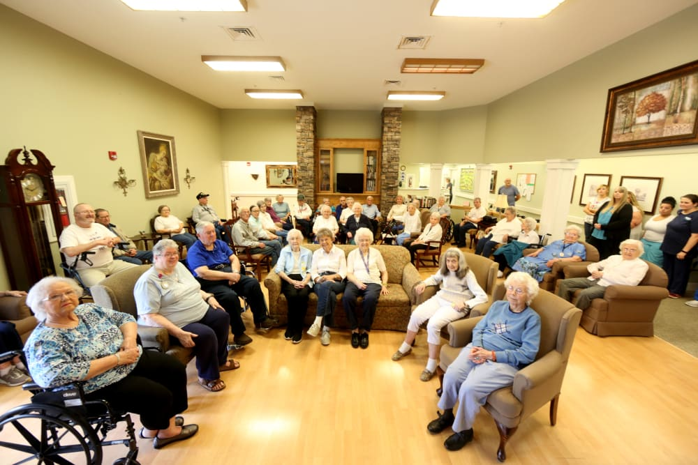 A group of residents in a community room at Providence Assisted Living in Clarksville, Arkansas.