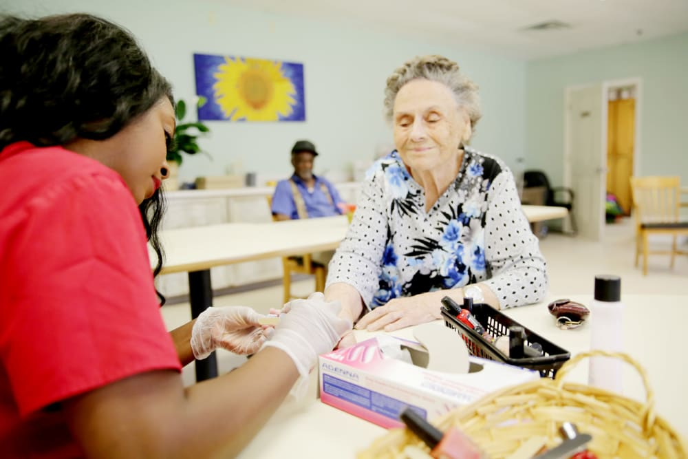 Resident getting her nails done at Providence Assisted Living in Cleveland, Mississippi.