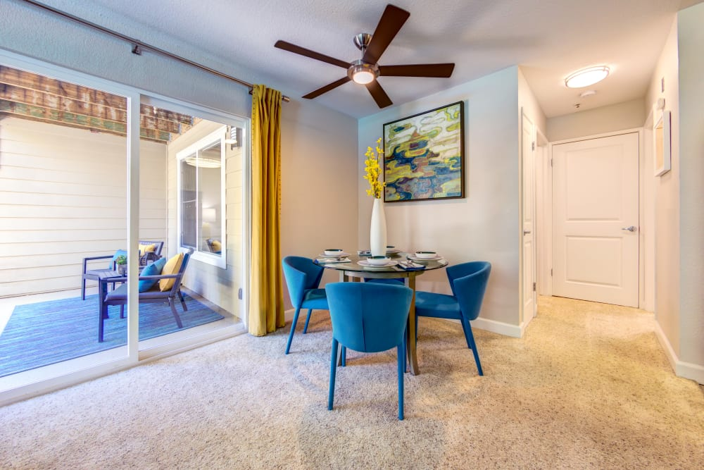 Dining area with a ceiling fan overhead in a model home at Sofi Sunnyvale in Sunnyvale, California