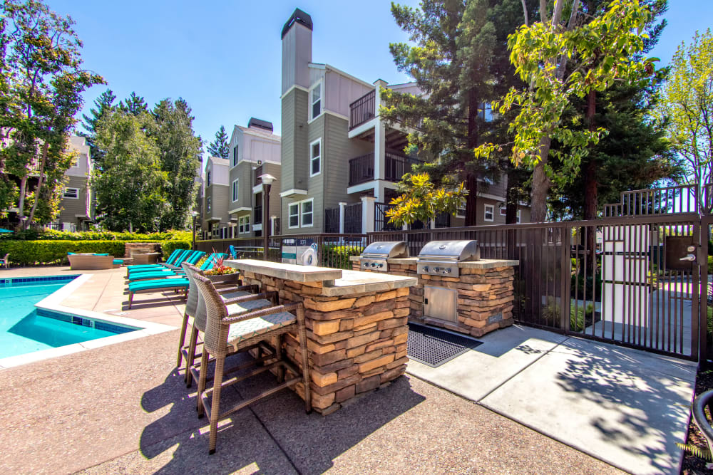 Barbecue area with gas grills near the pool at Sofi Sunnyvale in Sunnyvale, California