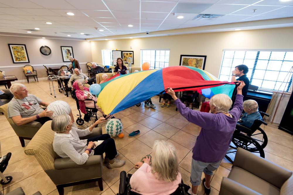 Residents playing a game at Inspired Living Alpharetta in Alpharetta, Georgia.