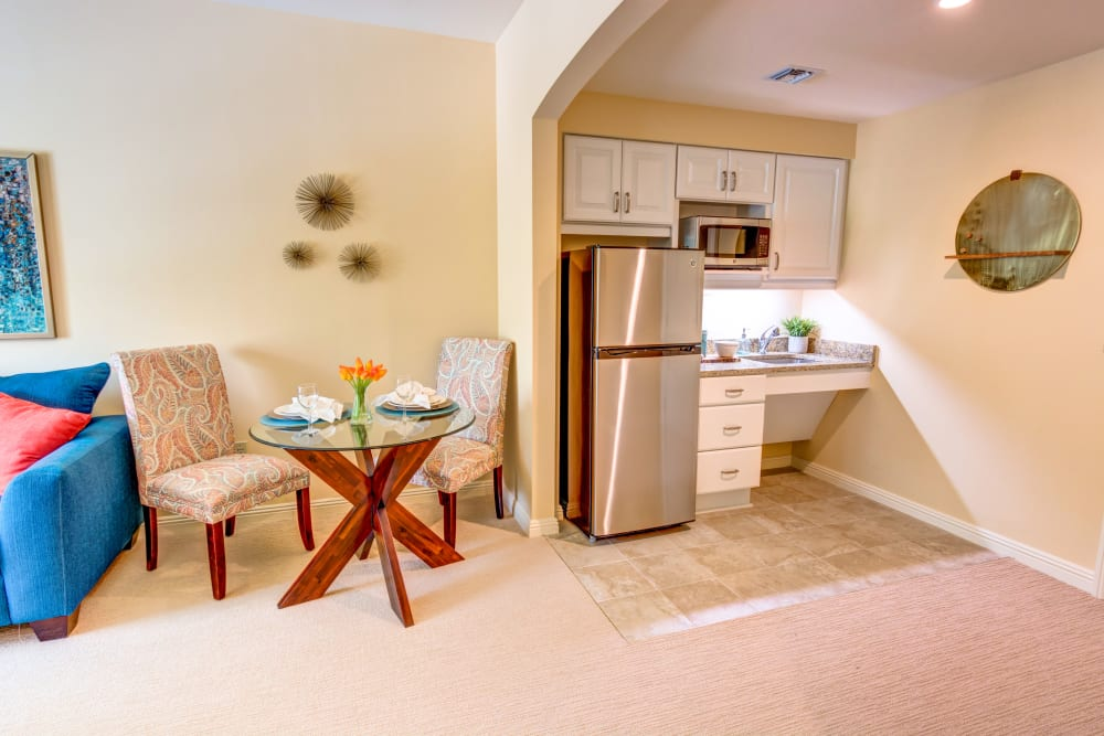 Assisted living apartment with partial kitchen at The Meridian at Boca Raton in Boca Raton, Florida