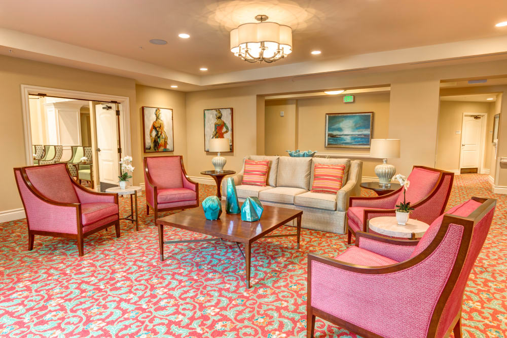 Meeting area with several chairs and a coffee table in The Meridian at Boca Raton in Boca Raton, Florida