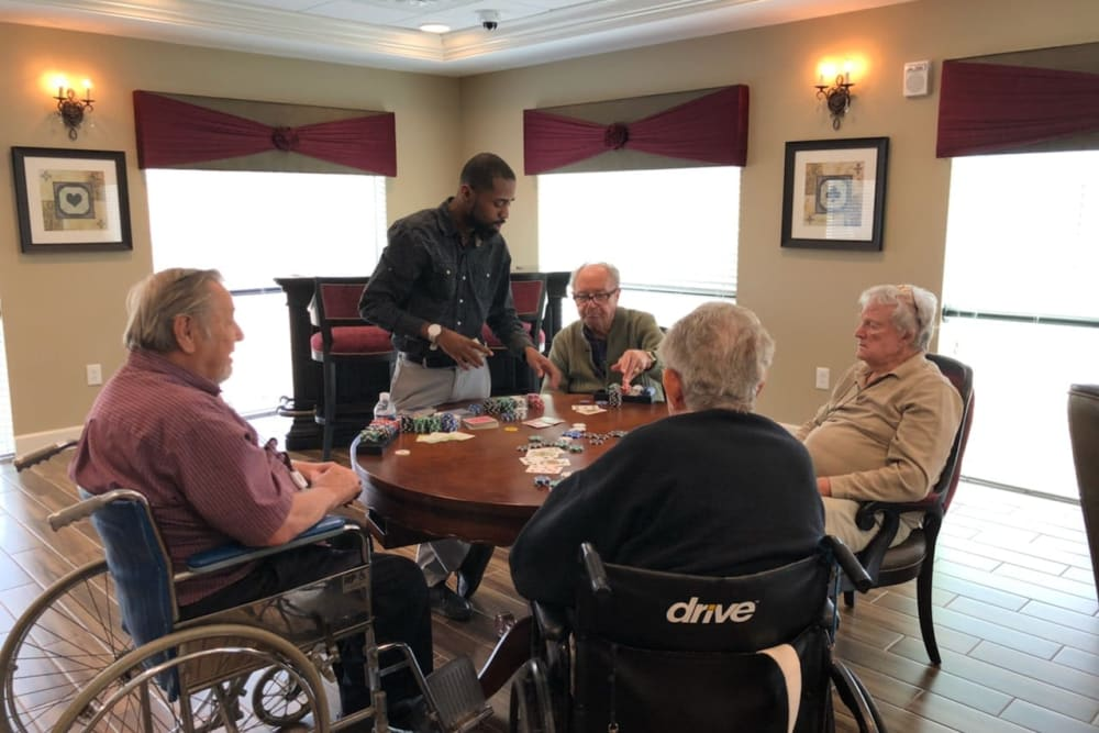 Residents playing cards at Inspired Living Alpharetta in Alpharetta, Georgia.