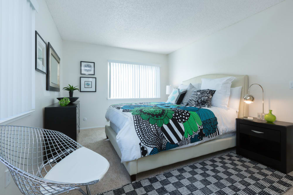 Colorfully decorated bedroom in a model home at Waterstone Fremont in Fremont, California