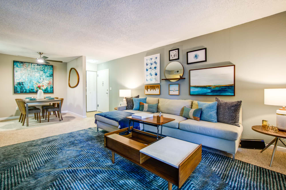 Well-furnished living space in a model home at Waterstone Fremont in Fremont, California