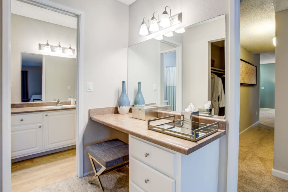 Large master bathroom with a makeup station in a model home at Waterstone Fremont in Fremont, California