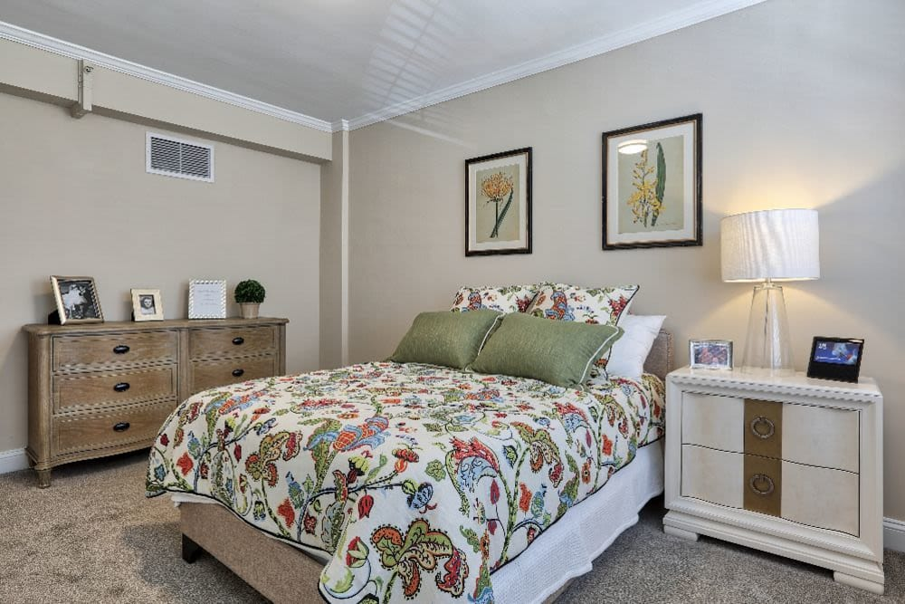 Bedroom with a bedside table and dresser at Chevy Chase House in Washington, District of Columbia