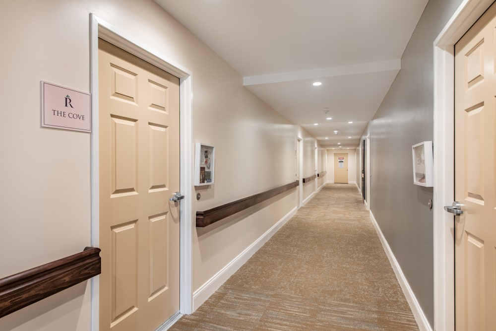 Large hallway connecting several apartments at Regency Palms Oxnard in Oxnard, California