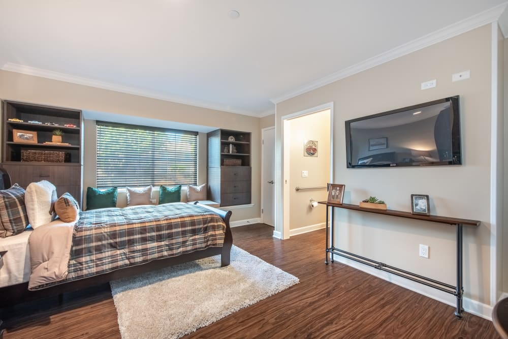 Studio apartment with a tv and a large window at Regency Palms Oxnard in Oxnard, California