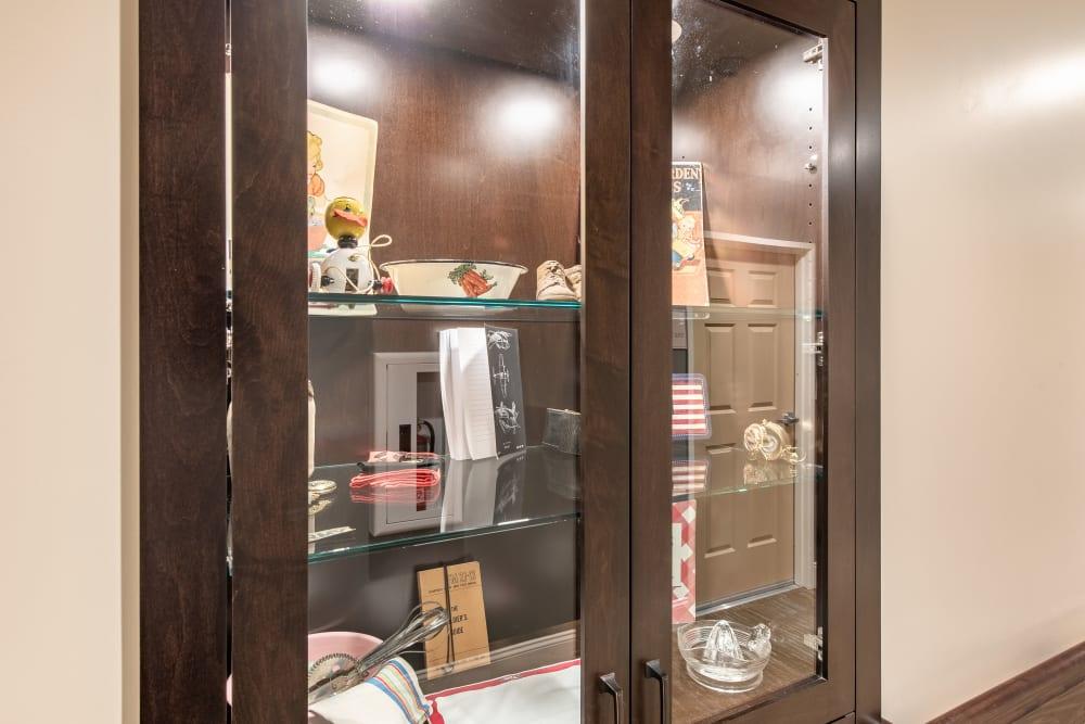 Cabinet filled with old memorabilia at Regency Palms Oxnard in Oxnard, California