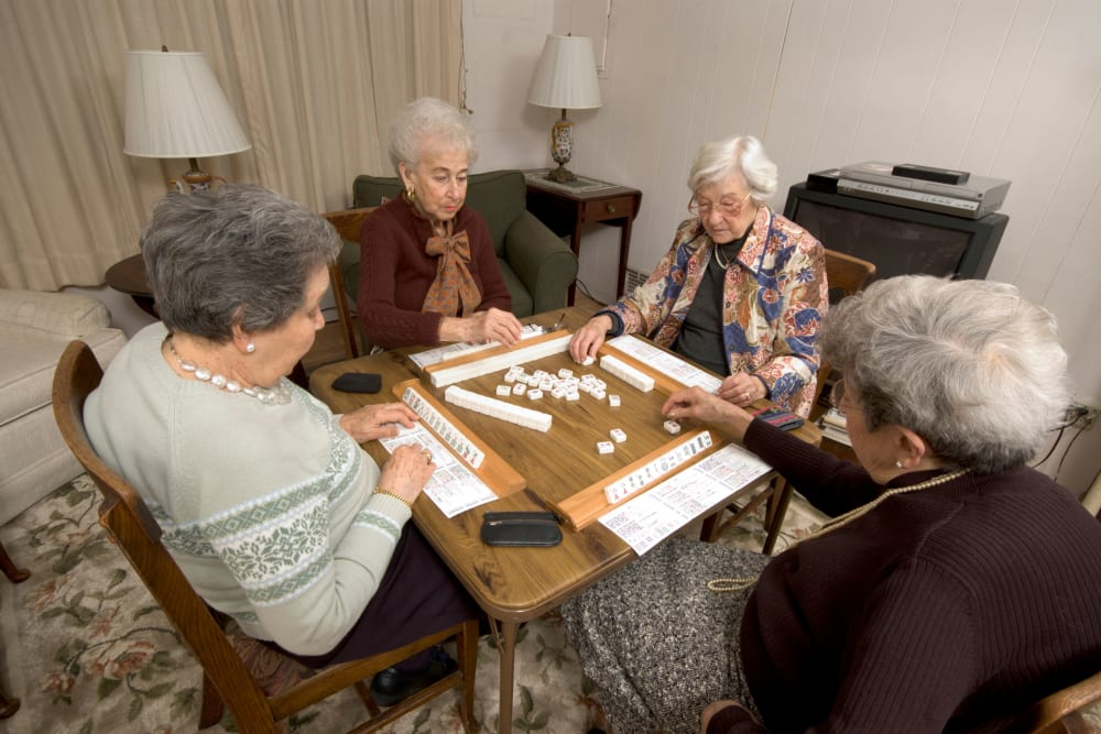 A group of residents playing a tile game at Honeysuckle Senior Living in Hayden, Idaho