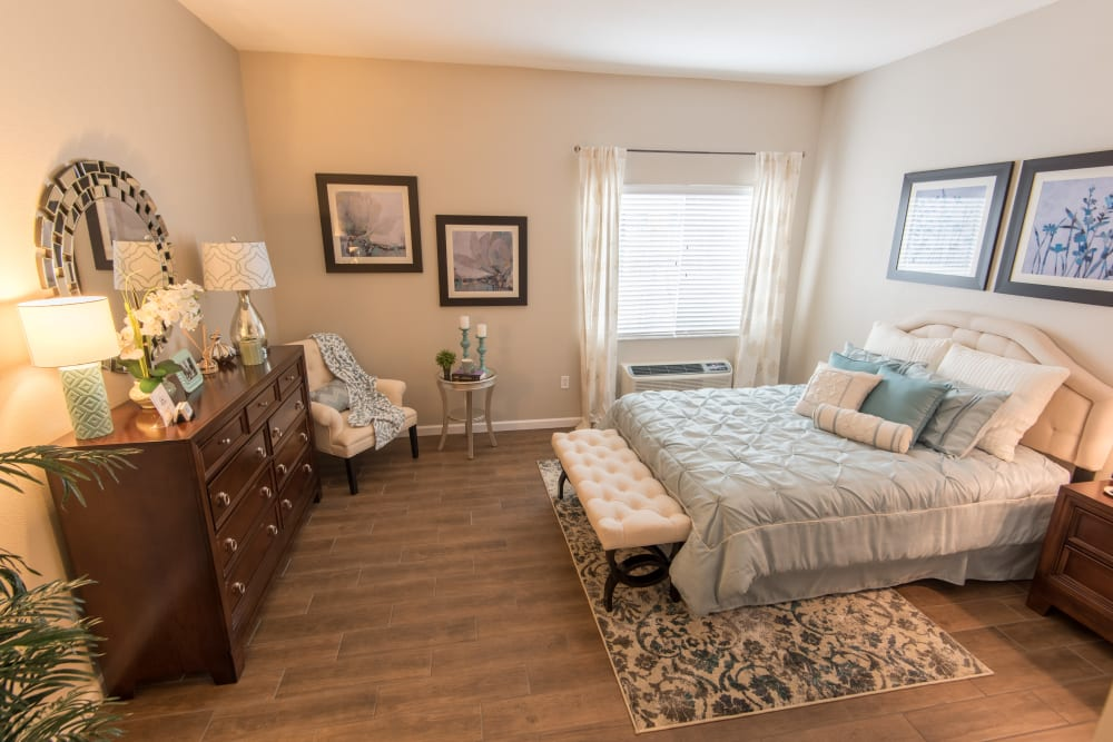 Spacious resident bedroom at Inspired Living Bonita Springs in Bonita Springs, Florida