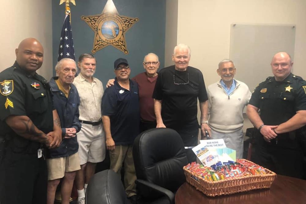 Residents and staff taking a picture with local police officers at Inspired Living at Bonita Springs in Bonita Springs, Florida.