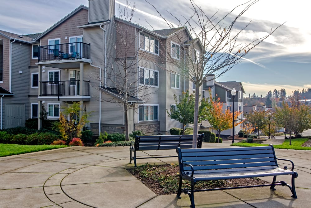 Exterior courtyard with benches for relaxing and admiring the neighborhood at Sofi at Cedar Mill in Portland, Oregon
