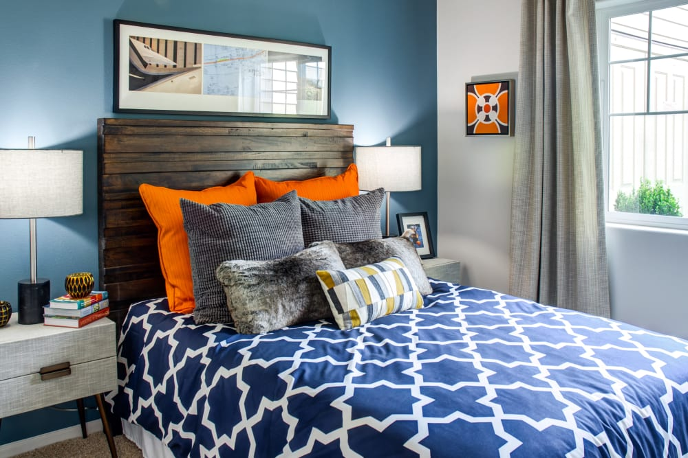 Accent wall and colorful decor in a model home's bedroom at Sofi at Cedar Mill in Portland, Oregon