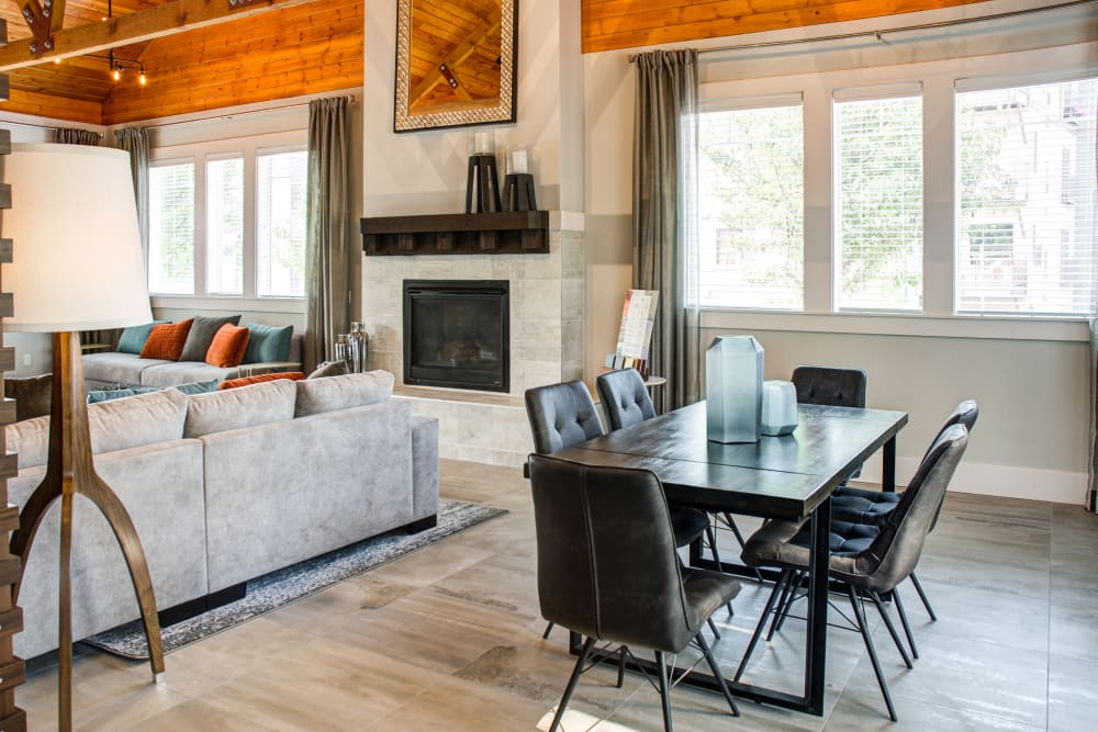 Fireplace, lounge area, and meeting tables in the clubhouse at Sofi at Cedar Mill in Portland, Oregon
