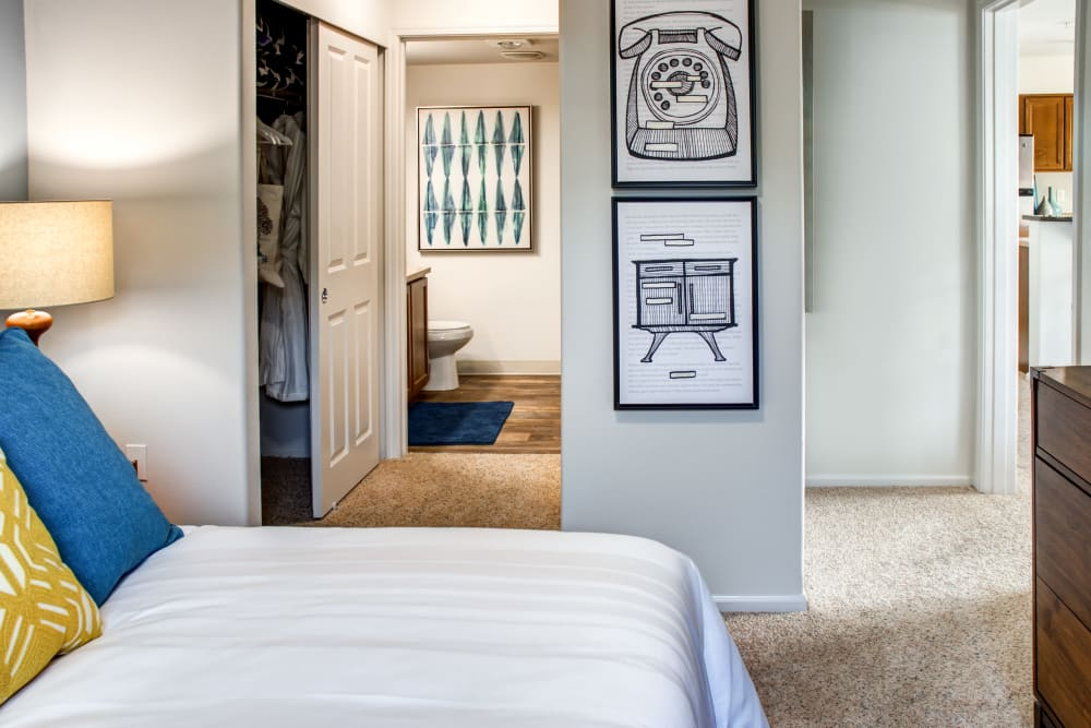 Master bedroom with an en suite bathroom and plush carpeting in a model home at Sofi at Cedar Mill in Portland, Oregon