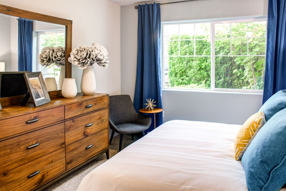 Well-furnished model home's master bedroom at Sofi at Cedar Mill in Portland, Oregon