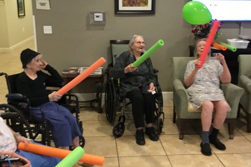 Residents playing a game at Inspired Living at Hidden Lakes in Bradenton, Florida