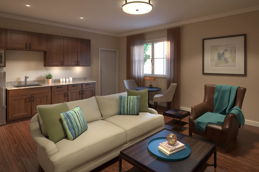 Senior apartment living room with a couch in several chairs at Regency Palms Oxnard in Oxnard, California