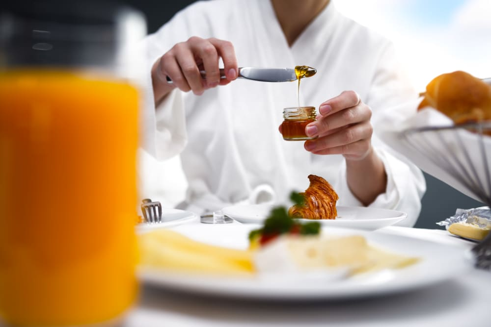 Meal being topped off by the chef at Meridian at Ocean Villa & Bella Mar in Santa Monica, California