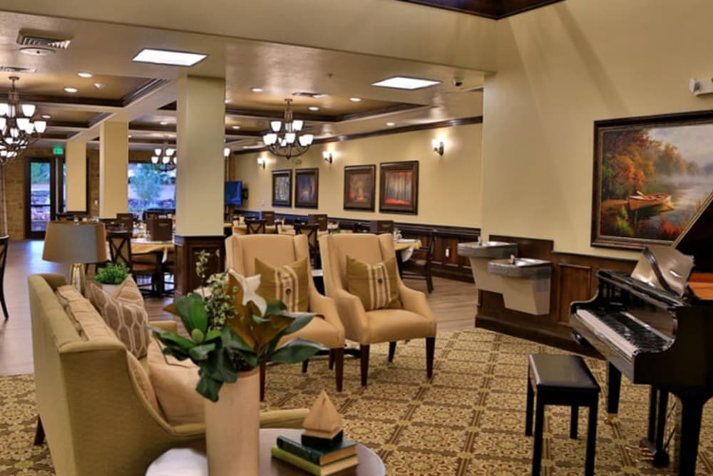 A common area with a piano at The Retreat at Sunbrook in St. George, Utah
