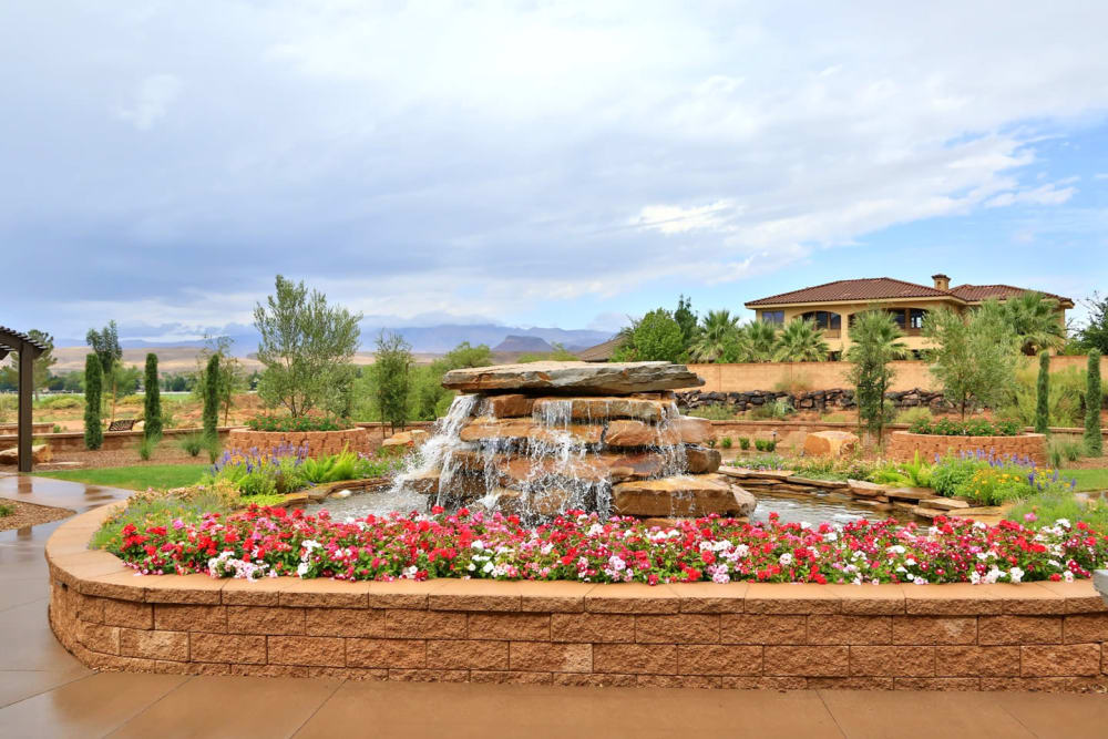 Beautiful flowers and a flowing fountain at The Retreat at Sunbrook in St. George, Utah