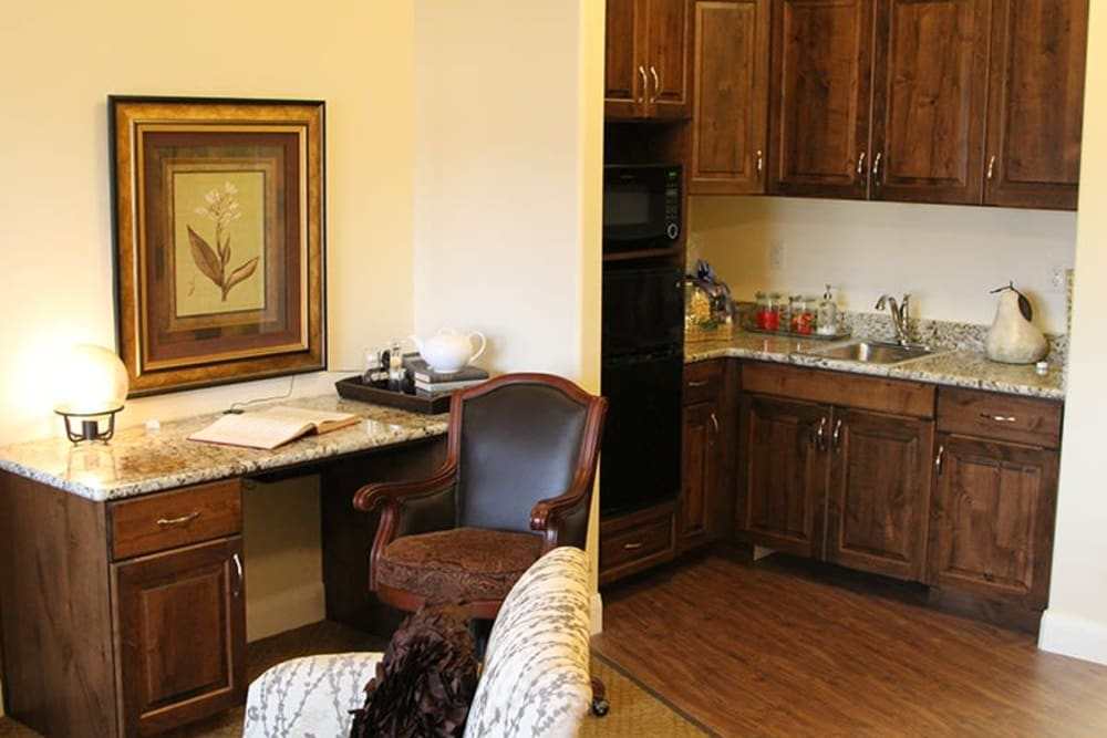 A desk and kitchen in an apartment at The Retreat at Sunriver in St. George, Utah