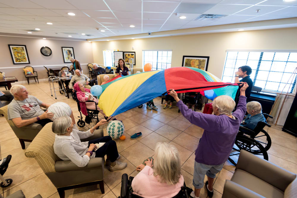 Residents playing a game together at Inspired Living at Lakewood Ranch in Bradenton, Florida.