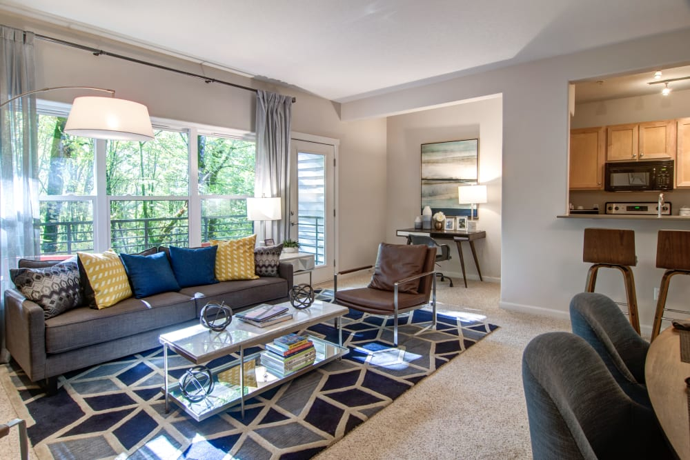 Modern furnishings in a model home's open-concept living area at Sofi at Forest Heights in Portland, Oregon